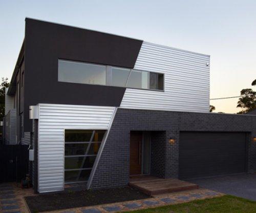 Metallic Monopanel® cladding enhances architect designed homes - Stramit Building Products Media Release
