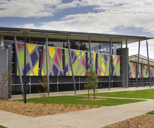 Radical roof line raises suburban library to community icon - Stramit Building Products Media Release